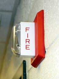 Fire alarm mounted to wall